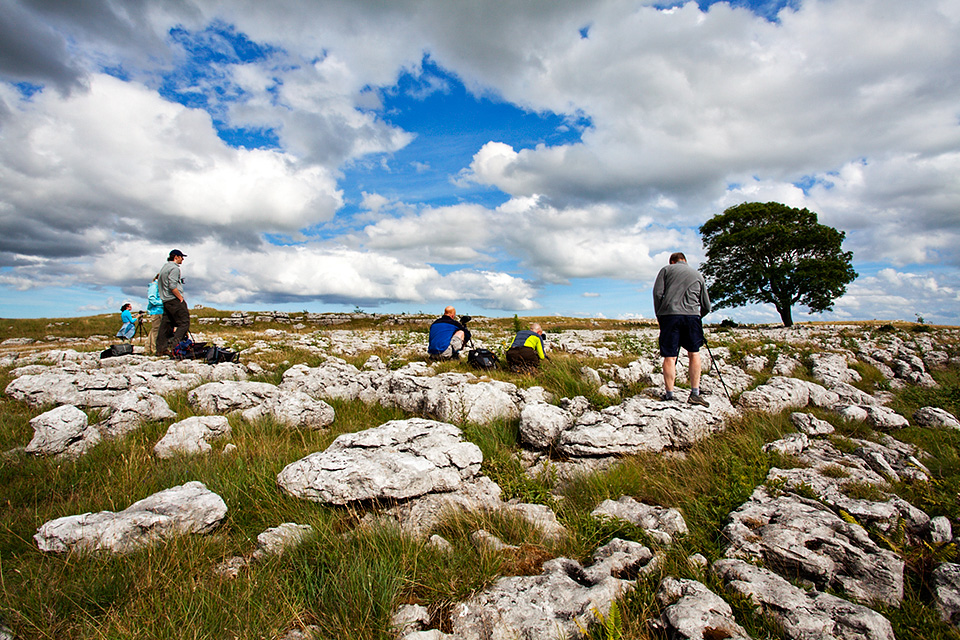 Photographing at the Lone Tree above Malham