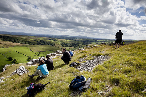 Enjoying fine views over Malhamdale from above Gordale Scar