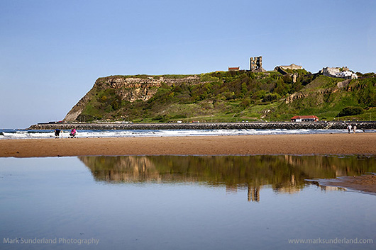 Castle Hill reflected in a Pool on North Sands Scarborough North. By Mark Sunderland