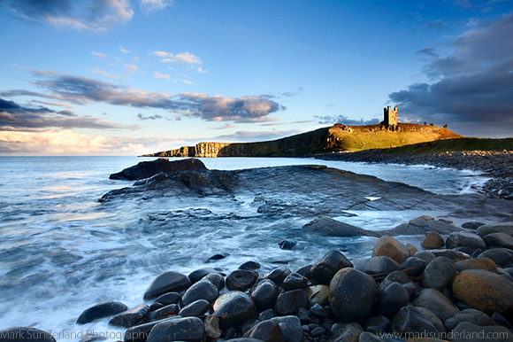 Dunstanburgh Castle at Sunset Northumberland Coast England