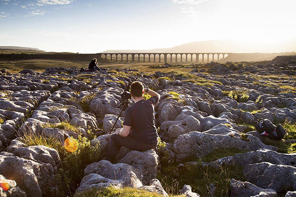 Warm evening light photographing Ingleborough and the Viaduct at Sunset. Sam Oakes