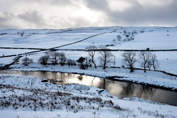 River Wharfe, Yorkshire Dales in snow between Kilnsey, Kettlewell and Arncliffe