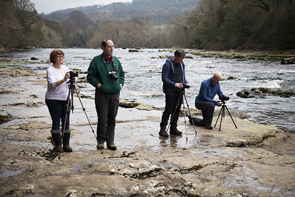 Photographers in a line at Lower Aysgarth Falls