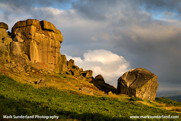 Clouds Clearing Over Cow and Calf Rocks at Sunrise