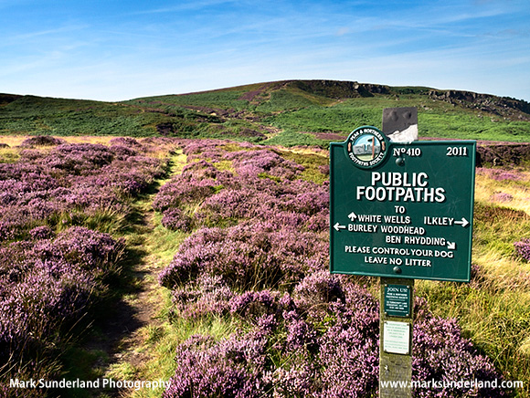 Footpaths Sign and Path Through Heather on Ilkley Moor